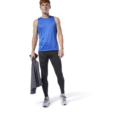 Feel comfortably covered from warm up to cool down. These men\'s fitted running tights are made of Speedwick fabric designed to pull sweat away from the skin. Mesh panels provide maximum ventilation and breathability, while reflective details offer enhanced visibility on low-lit runs. 86% polyester / 14% spandex single jersey Designed for: Running Fitted fit Speedwick fabric wicks sweat to help you stay cool and dry Reflectivity for added low-light visibility Mesh panels for ventilation and breathability Imported