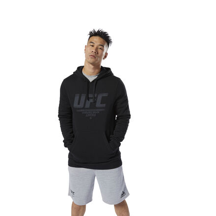 Show your fandom with this UFC men\'s graphic hoodie. A drawcord on the hood lets you adjust your coverage in cold weather so you can focus during warm-ups. It\'s made of soft fleece to keep you warm during gym commutes. 80% cotton / 20% polyester fleece Designed for: UFC fans Regular fit Kangaroo pocket Drawcord on hood for adjustability Long sleeves with banded cuffs We partner with the Better Cotton Initiative to improve cotton farming globally