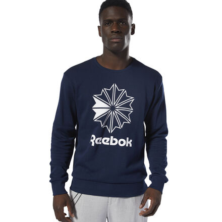 This classic crewneck features a bold, iconic graphic front and center. French terry fabric makes a cozy layer as you take to the streets. Pair this sweatshirt with your favorite tee and joggers for a classic and casual look. Designed for: Casual looks, everyday wear Crew neckline for easy wear Iconic graphic Imported