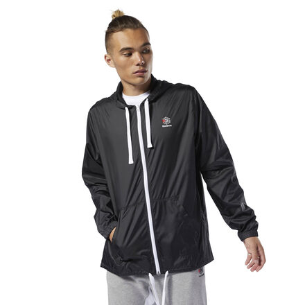 Layer up in style in this men\'s windbreaker. This tried-and-true look won\'t let a little chill slow you down. The Starcrest logo gives the jacket an old-school vibe. 100% polyester plain weave Relaxed fit Drawcords on hood and hem for adjustability Mesh lining for breathability Graphic on back Imported