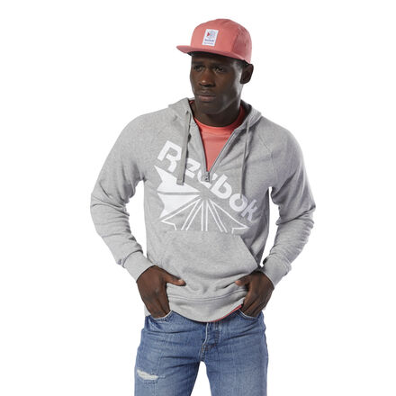 Layer up in old-school style with a twist. This men\'s half-zip hoodie shows off the iconic Starcrest logo in an oversize split diagonal design. The sweatshirt has a kangaroo pocket and drawstring-adjustable hood to complete the classic style. 100% cotton French terry Regular fit Kangaroo pocket keeps hands warm Half zip Drawcord on hood for adjustability We partner with the Better Cotton Initiative to improve cotton farming globally Imported