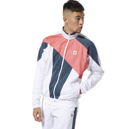 Straight from the archives. This men\'s track jacket flashes a retro look with bold blocks of color. The full-zip style is an easy go-to layer for every day of the week. 63% cotton / 37% polyester doubleknit Regular fit Elastic cuffs and hem for a stay-put fit Translucent overlay Imported