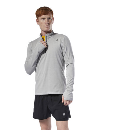 The perfect layering piece for your cool-morning runs, our long sleeve pullover comes with a quarter-length zipper making it easy to get on and off. Stay warm and comfortable for your gym warm-up or on brisk days outdoors. Materials: 90% Polyester/10% Elasthane Fit: Slim fit - wears tight against the body and moves with you during exercise Best for: Outdoor running, layering, cool weather Speedwick fabric wicks sweat to help you stay cool and dry; Mesh back panel for ventilation and breathability Quarter zip with stand-up collar; Side zip pocket for small essentials Articulated elbows for ease of movement; Thumbholes keep sleeves in place Reflective details for added low-light visibility