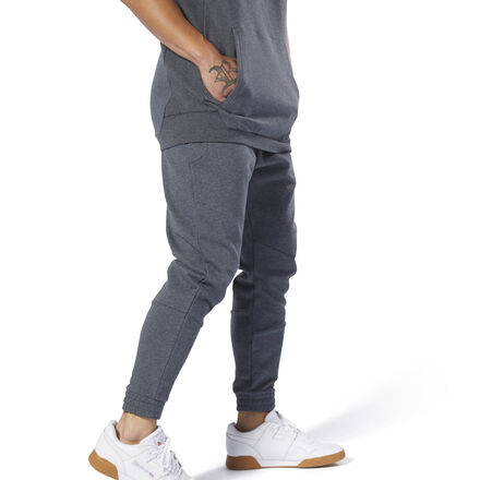 A classic look remastered. These men\'s joggers are made of soft, heavyweight cotton for enhanced, everyday comfort. Cut to stay close to your body, they\'re built with banded cuffs and an elastic waistband for a snug, secure fit. A slight drop crotch and tapered legs keep them modern. Concealed zip pockets store your essentials. 100% cotton French terry Designed for: Warmups Slim fit Elastic waist for a secure fit Concealed zip side pockets for storing essentials Sight drop crotch and tapered legs; Cuffed hems for a secure fit We partner with the Better Cotton Initiative to improve cotton farming globally