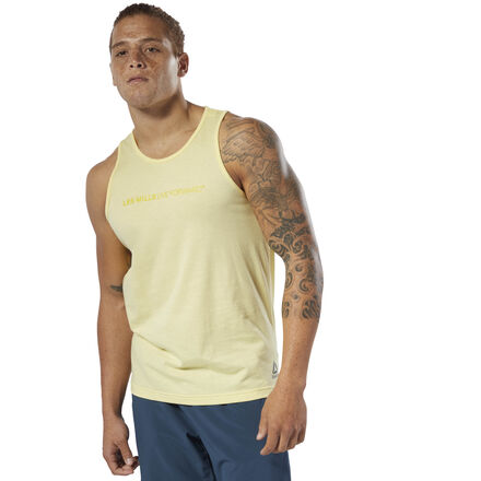 The sweat-wicking fabric of this men\'s tank top works to keep you cool and dry so you stay focused. It\'s made of lightweight jersey in a minimalist design and features a LES MILLS graphic on the chest. 60% cotton / 40% polyester single jersey Designed for: Any type of workout Slim fit Speedwick fabric wicks sweat to help you stay cool and dry ????Better Cotton Initiative????????,?????????????? We partner with the Better Cotton Initiative to improve cotton farming globally Imported
