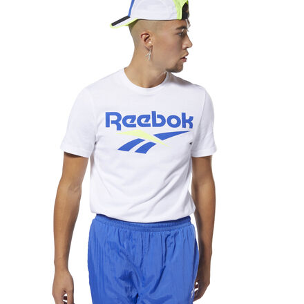 Flash a retro look in bold color. This men\'s tee puts vintage Reebok style front and center with a bold Vector logo. The t-shirt has a soft cotton build that makes it a comfortable go-to for your daily rounds. 100% cotton single jersey Regular fit Reebok Vector graphic on front We partner with the Better Cotton Initiative to improve cotton farming globally Imported