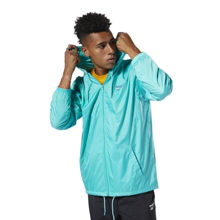 Vector logos give a retro vibe to this men\'s windbreaker. Made of lightweight plain weave, it has a loose, relaxed fit for a casual feel. 100% polyester plain weave Front zip; Elastic cuffs Adjustable drawcord on hood and hem Reebok Vector logo on back Relaxed fit Imported