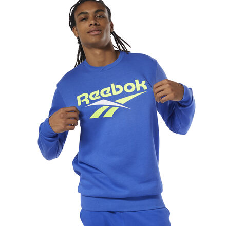 Vintage Reebok style, front and center. This men\'s sweatshirt shows off a bold Vector logo. Born in the \'90s, the iconic symbol was inspired by the look of classic Reebok shoes. The soft fleece build keeps it simple. 80% organic cotton / 20% polyester fleece Relaxed fit Ribbed crewneck with overlap detail Reebok Vector graphic on chest This sweatshirt is made with organic cotton to save water and conserve energy Imported