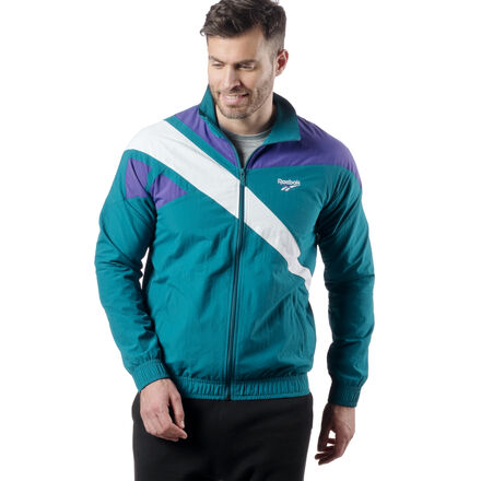 You\'ve found it. Brought forward from the vault, this �90s-inspired zip-up jacket is perfect company for warming up a jeans ensemble or pairing with our Vector Track Pants to complete the heritage look. Reebok�s iconic vector logo sweeps across the shoulders for a bold refresh of an era-spanning classic. 100% Nylon, plain weave fabric for classic comfort Relaxed Fit - wears looser for traditional comfort and style Full-zip front with vector branded zipper pull Elasticated cuffs and hem for a stay-put fit Front pockets for storage Cut-and-sew vector panels and raglan sleeves for an authentic vintage look Single jersey lining for comfort