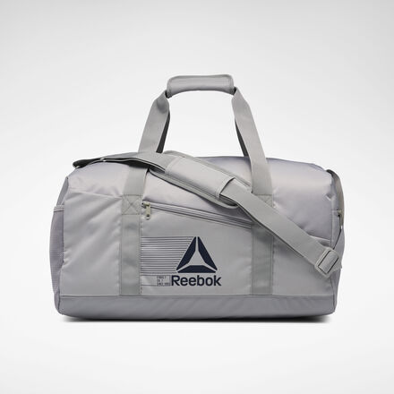 Athletes on the go will appreciate the handy design of this duffel bag. A main compartment and a separate laptop sleeve inside means you\'ll stay organized. The cushioned handles provide comfort when carrying a lot of gear. 100% polyester Dimensions: 12\